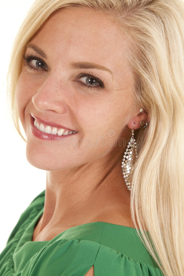 Головка усмешки взгляда женщины зеленая верхняя стоковое фото rf