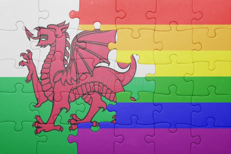 Головоломка с национальным флагом вэльса и гомосексуалист сигнализируют стоковые изображения
