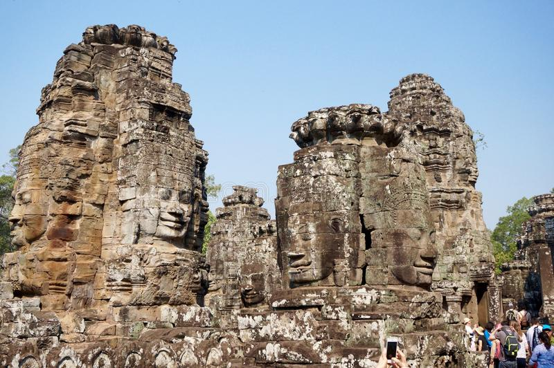 Головы на виске Bayon, Камбодже стоковая фотография
