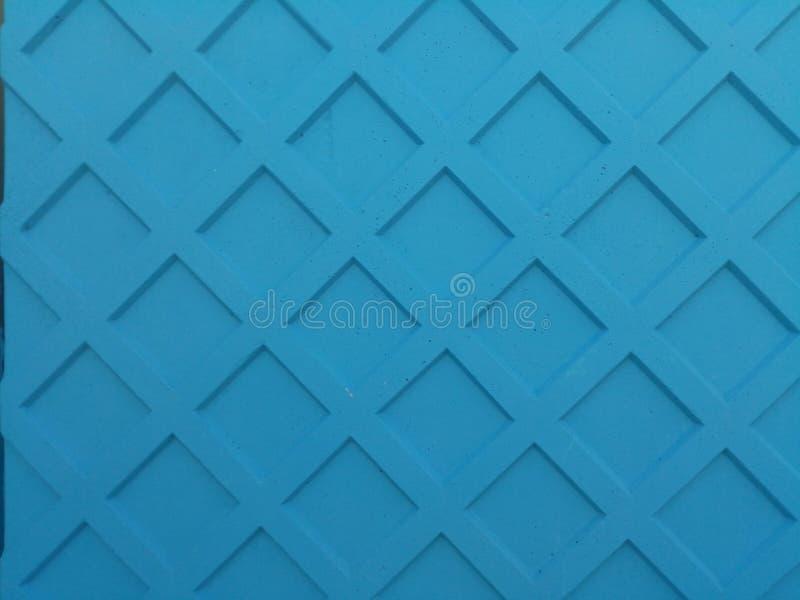 Голубая абстрактная предпосылка Покрашенная конкретная загородка с текстурой формы косоугольника стоковые изображения rf