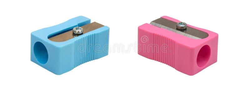 Голубая и розовая точилка для карандашей изолированная на белой предпосылке стоковые изображения