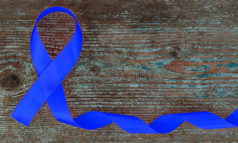 Голубая лента, рак толстой кишки, колоректальная Карцинома, осведомленность насилия над ребенком, день диабета мира стоковое изображение rf