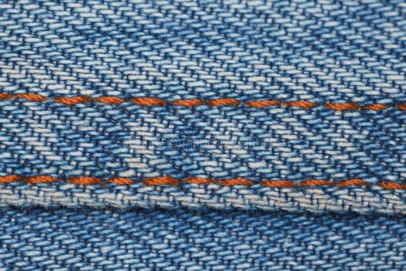 голубая линия желтый цвет джинсовой ткани структуры части стоковая фотография rf