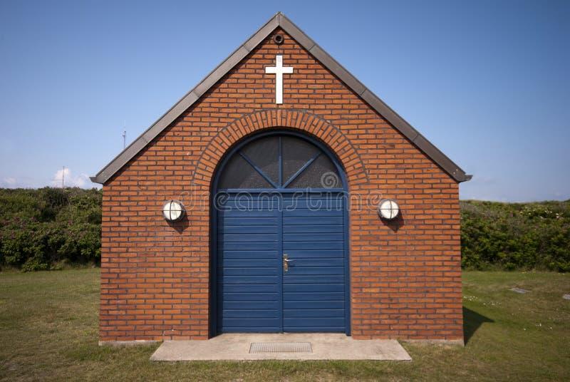 голубая перекрестная белизна двери стоковое фото