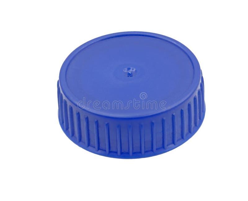 Голубая пластичная крышка бутылки стоковые изображения