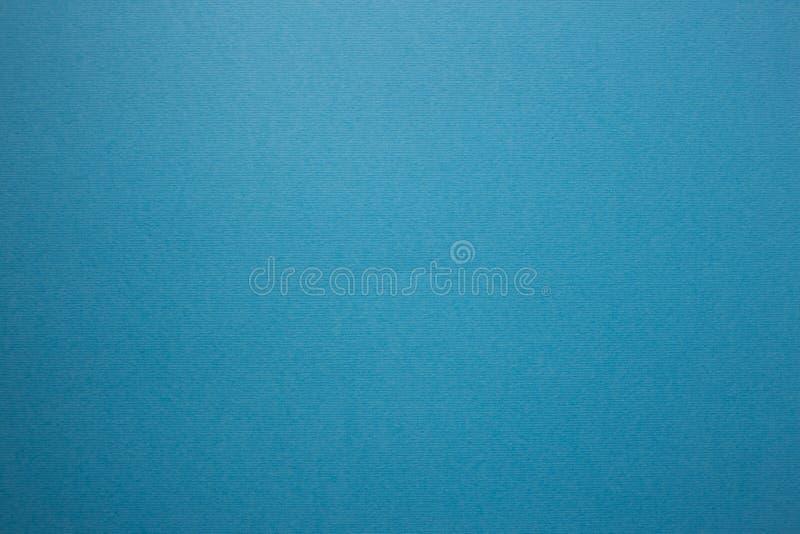 Голубая предпосылка, текстурированная выбитая поверхность для дизайна стоковое изображение rf