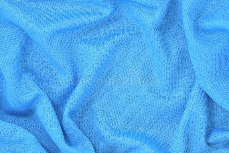 Голубая предпосылка текстуры ткани полиэстера jersey, спорт носит предпосылку стоковые фото
