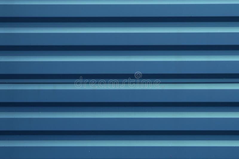 Голубая рифленая текстура панели металла r Материал толя и отделка здания стоковые фото