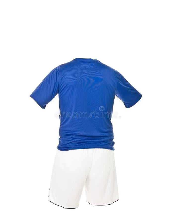 голубая рубашка футбола замыкает накоротко белизну стоковые фото