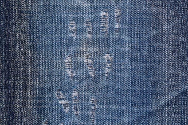 Голубая ткань джинсов джинсовой ткани с огорченной картиной текстуры, несколько стоковая фотография rf