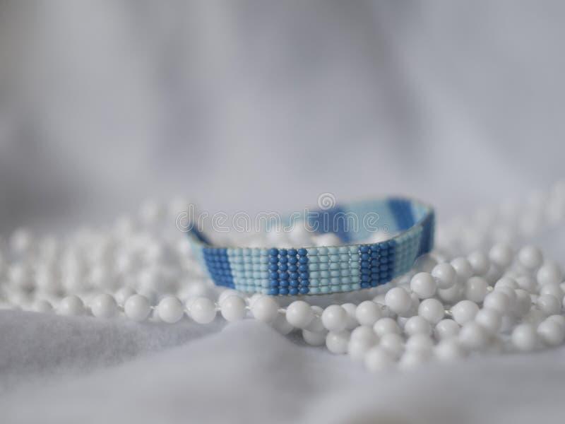 Голубое семя отбортовывает браслет стоковые фото