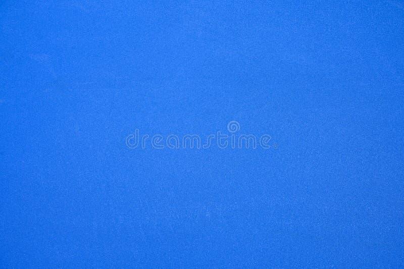 Голубое синтетическое резиновое поле теннисного корта стоковые фото