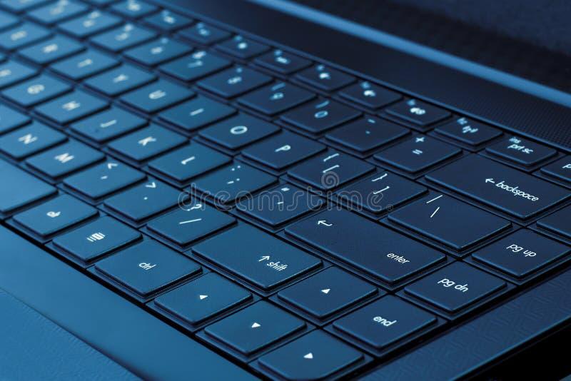 голубой тон компьтер-книжки клавиатуры стоковое изображение rf