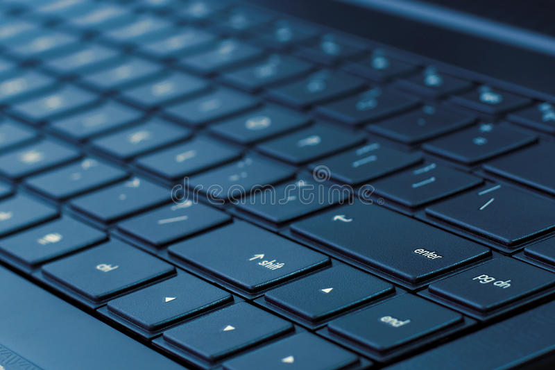 голубой тон компьтер-книжки клавиатуры стоковое фото rf