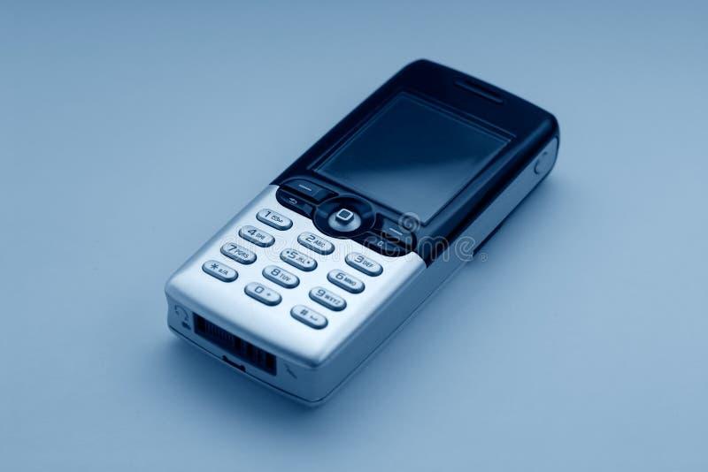 голубой тон мобильного телефона стоковые изображения