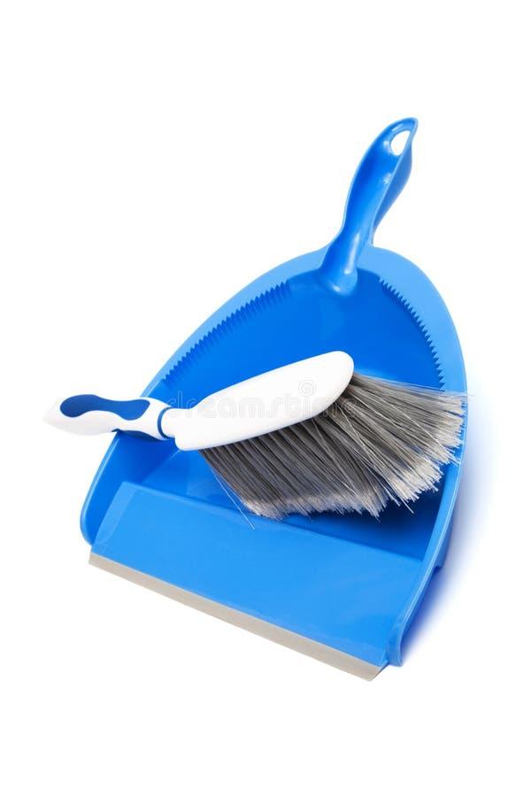 голубой dustpan щетки стоковые изображения