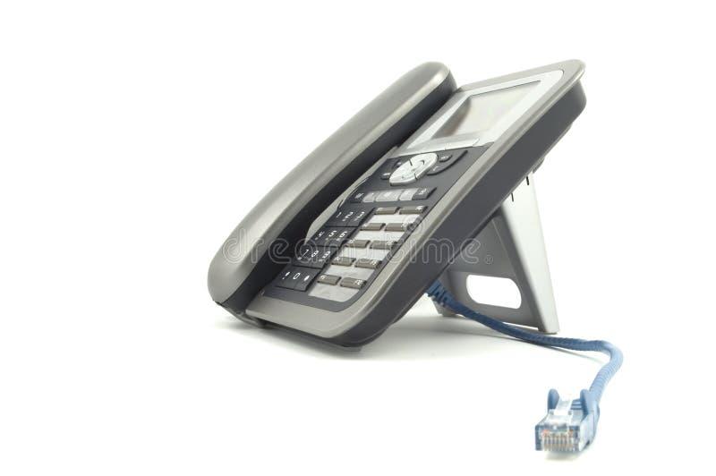 голубой ip локальных сетей кабеля над голосом телефона стоковое фото rf
