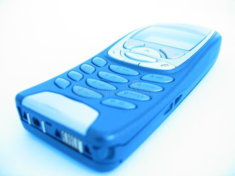 голубой shine сотового телефона стоковое фото