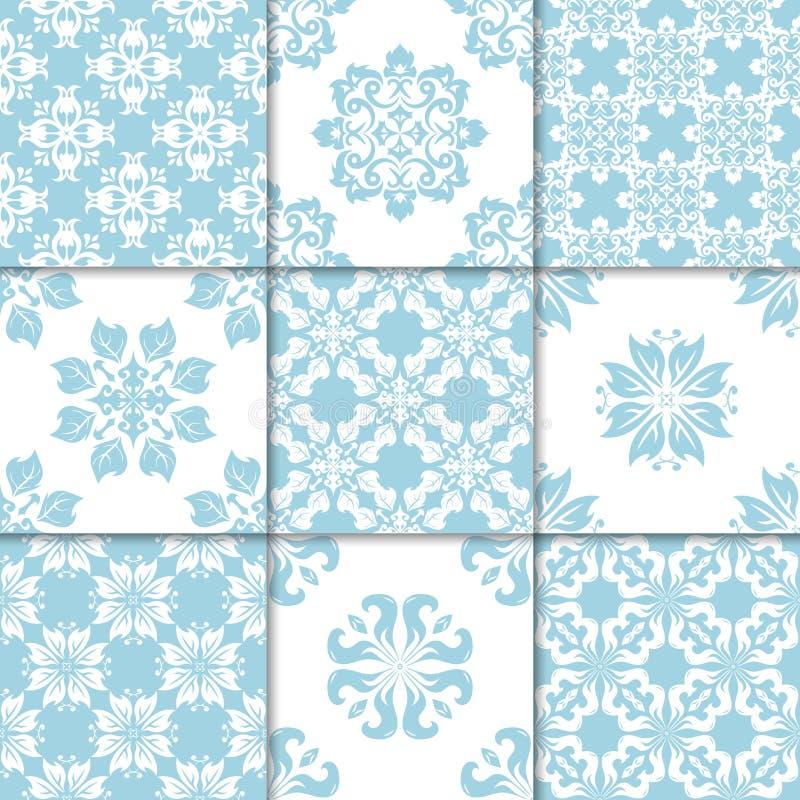 Голубые и белые флористические орнаменты собрание делает по образцу безшовное бесплатная иллюстрация