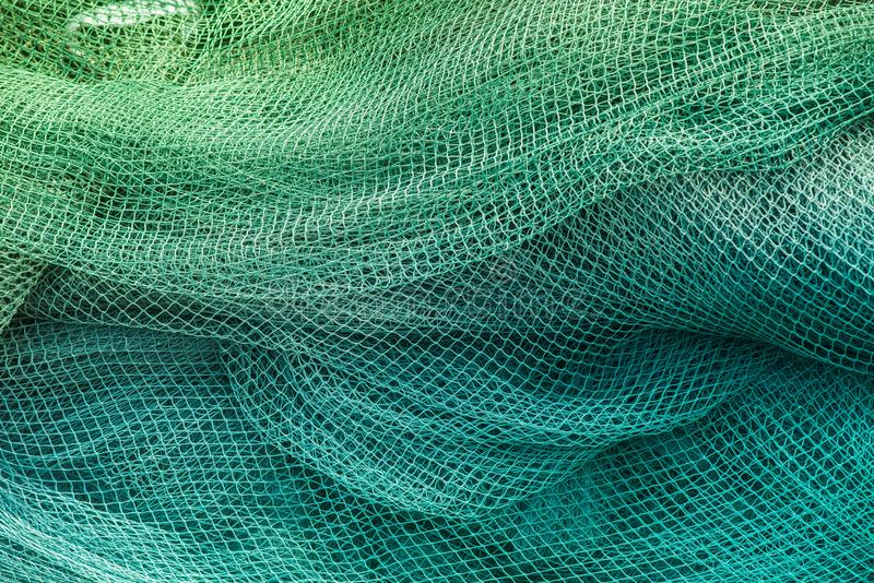 Голубые и зеленые рыболовные сети стоковое фото rf