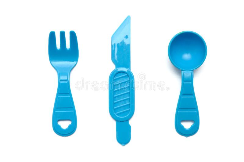 Голубые пластичные игрушки вилки, ветроуловителя и ножа стоковая фотография