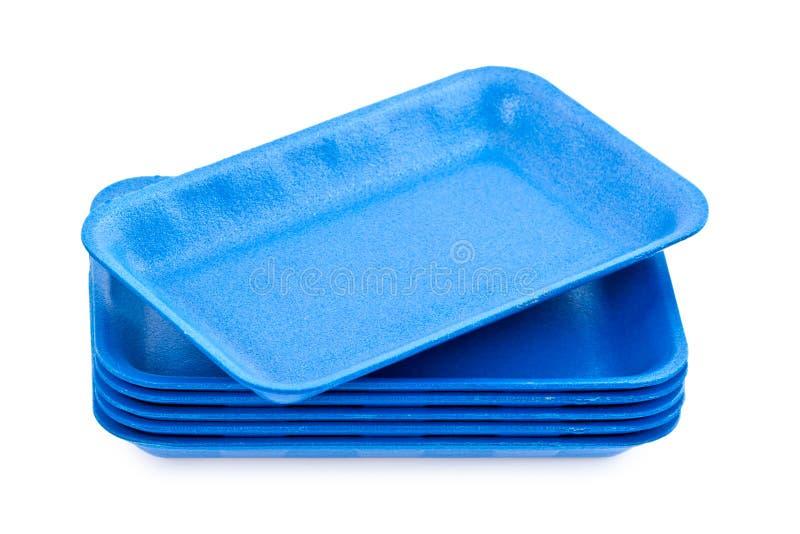 голубые пустые подносы стиропора стоковые изображения