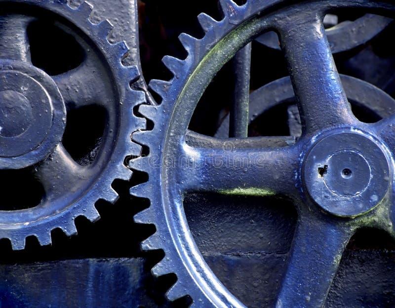 голубые шестерни стоковое изображение