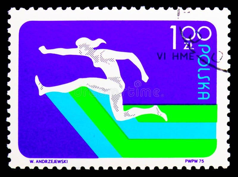 Гонка барьера женщин, 6-ые европейские крытые атлетические чемпионаты, serie Катовице, около 1975 стоковая фотография