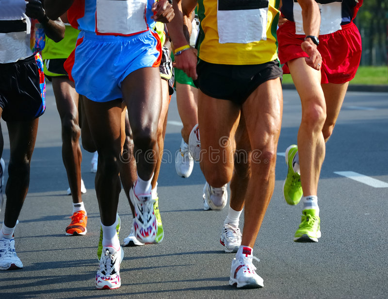 гонщики марафона стоковое фото