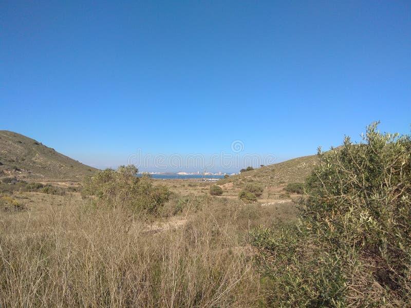 Гора, море и небо стоковое изображение rf