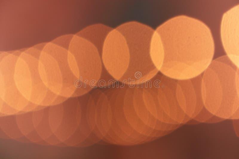 Горизонтальные запачканные электрические лампочки текстуры в кафе, абстрактной предпосылке стоковая фотография