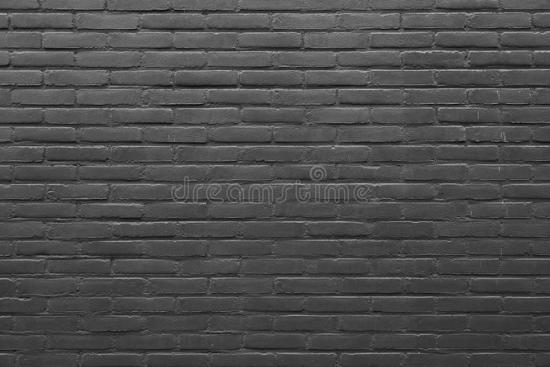Горизонтальная часть кирпичной стены покрашенной серым цветом стоковое фото rf