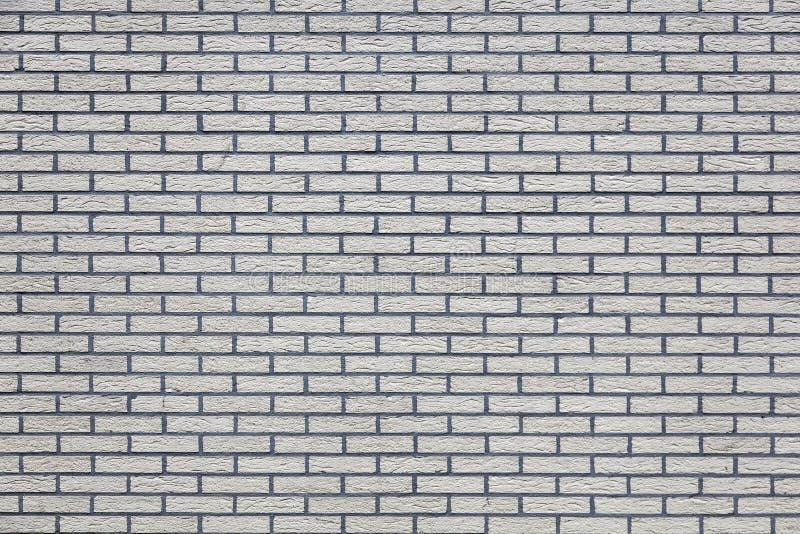 Горизонтальная часть кирпичной стены покрашенной серым цветом стоковая фотография