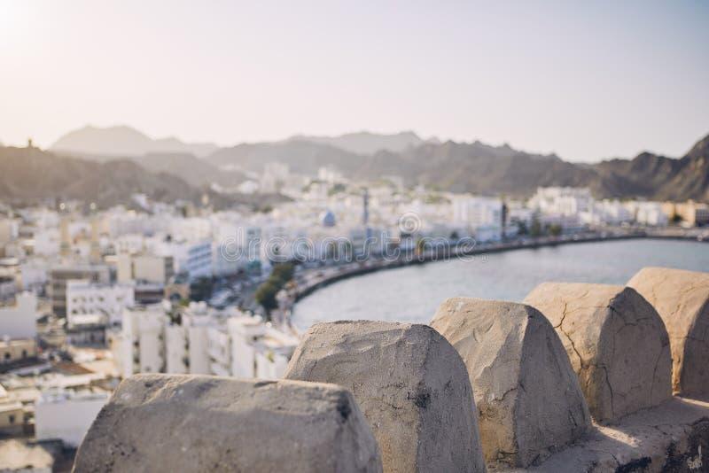 Город Muscat на заходе солнца стоковые фотографии rf