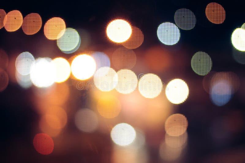 Городская жизнь в ноче в абстрактной предпосылке Bokeh дороги светлое Концепция вождения автомобиля ночи стоковая фотография