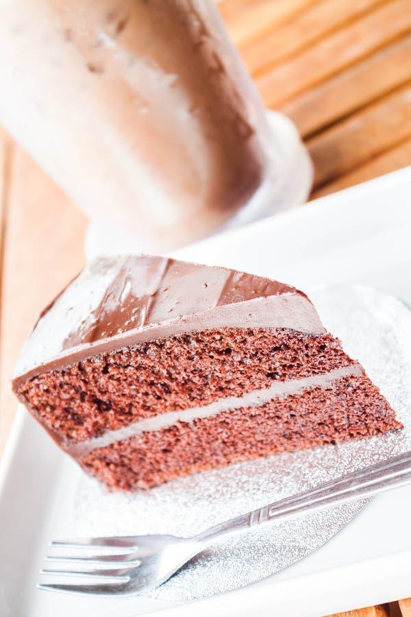 Горькая помадка с холодными кофе и шоколадным тортом стоковое фото