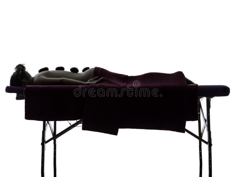 Горячий силуэт терапией массажа lastones стоковое фото