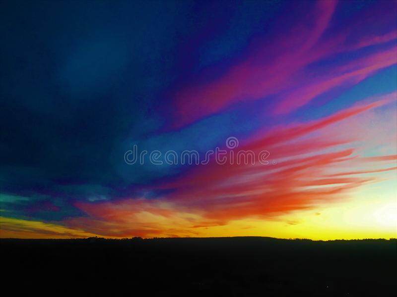 Горя жизнь, цвета, заход солнца, небо и безграничность стоковые изображения