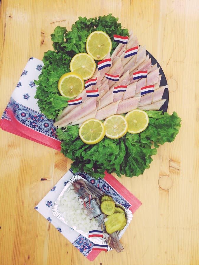Голландская еда рыб стоковое изображение rf