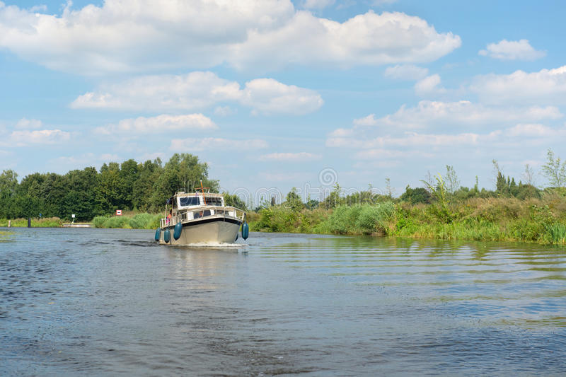 Голландское река с меньшей шлюпкой стоковое фото