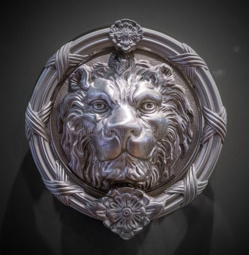 Lion head statue tattoo