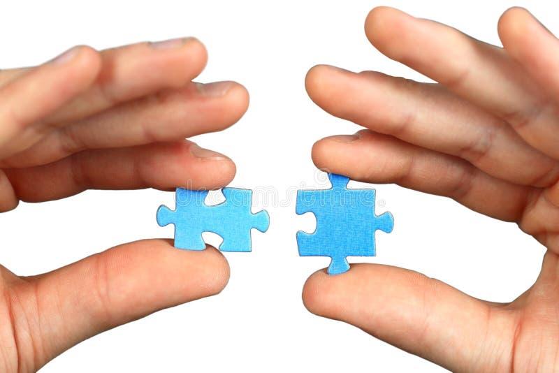 головоломки 2 рук стоковая фотография rf