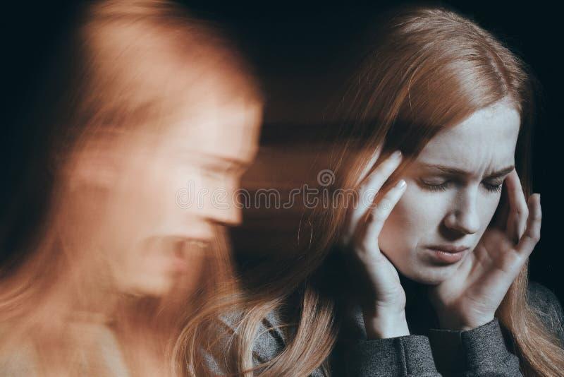 Голоса слуха женщины стоковое фото