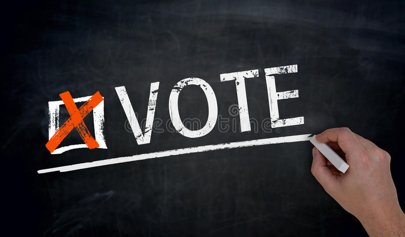 Голосование написано вручную на классн классном стоковое фото rf