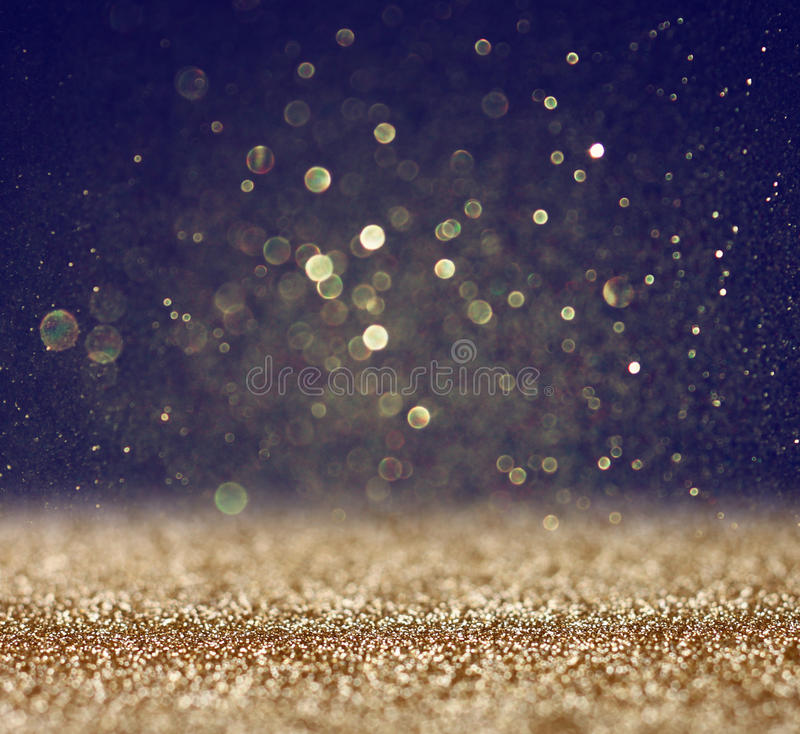 Год сбора винограда яркого блеска освещает предпосылку светлое золото и чернота defocused стоковое фото rf