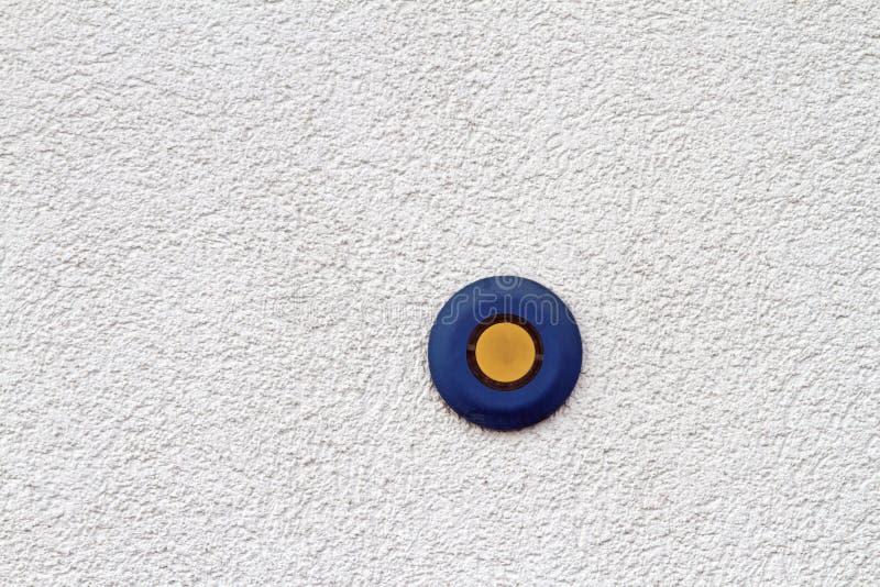 Голубая и желтая кнопка стоковое фото