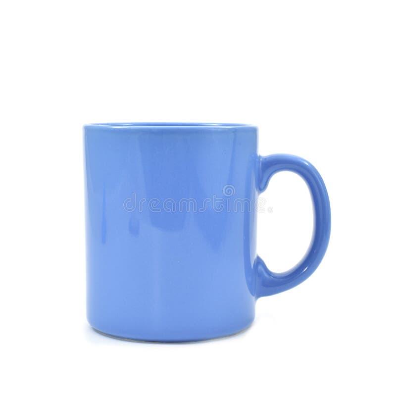 Голубая керамическая кружка стоковое изображение