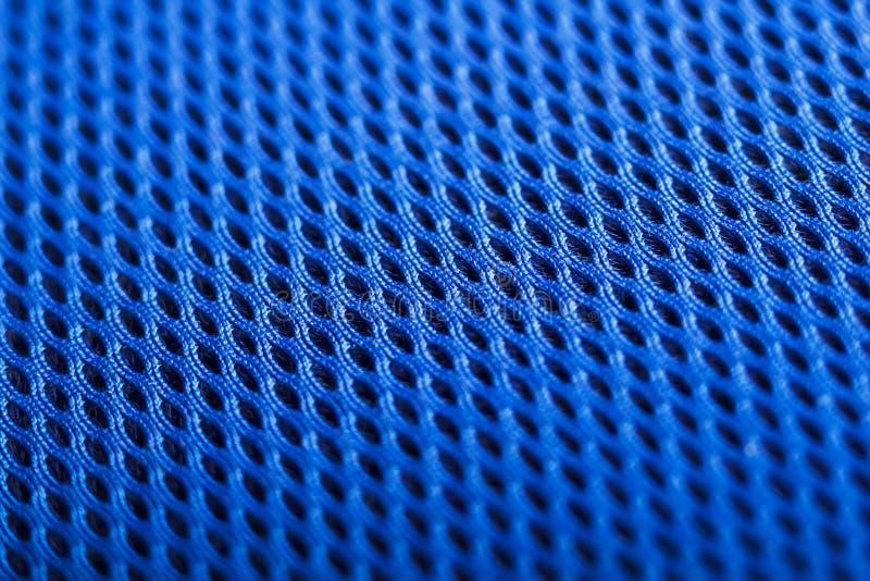 Голубая предпосылка. Текстура ткани сетки. Макрос стоковое фото