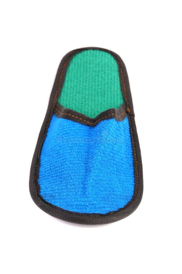 Голубая тапочка на белой предпосылке. стоковое изображение rf