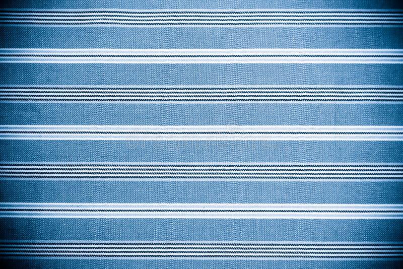 Голубая текстура ткани. Одевает предпосылку стоковое изображение rf